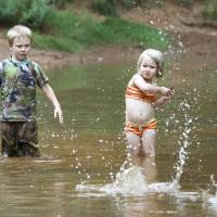 Photo - Eli Steele, 5, and his sister Bryar, 3, skip rocks while wading at Martin Park, Wednesday, June 13, 2012. Martin Park Nature Center will be opening at 8 a.m. starting Saturdays through July 29 so that people can enjoy the park earlier. Photo By David McDaniel/The Oklahoman