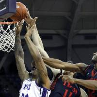 Photo - TCU's Adrick McKinney (24) goes to the basket against Texas Tech's Dejan Kravic (11) and Jordan Tolbert, right, during an NCAA college basketball game Saturday, Jan. 5, 2013, in Fort Worth, Texas. Texas Tech defeated TCU 62-53. (AP Photo/The Fort Worth Star-Telegram, Joyce Marshall) MAGS OUT; (FORT WORTH WEEKLY, 360 WEST); INTERNET OUT