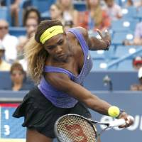 Photo - Serena Williams returns a volley to Caroline Wozniacki, from Denmark, during a semifinal match at the Western & Southern Open tennis tournament, Saturday, Aug. 16, 2014, in Mason, Ohio. (AP Photo/David Kohl)