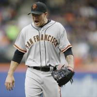 Photo - San Francisco Giants starting pitcher Jake Peavy reacts while walking off the field after pitching during the first inning of a baseball game against the New York Mets on Saturday, Aug. 2, 2014, in New York. (AP Photo/Frank Franklin II)