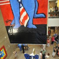 Photo - ?Rodrigue: Blue Dogs in Texas? features more than 110 works by the Louisiana artist George Rodigue. PHOTO BY ELAINE WARNER, FOR THE OKLAHOMAN..