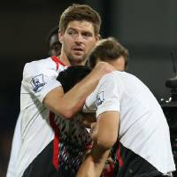 Photo - Liverpool's Steven Gerrard, left, reacts with teammate Luis Suarez, following the end of the English Premier League soccer match between Crystal Palace and Liverpool at Selhurst Park stadium in London, Monday, May 5, 2014. The game ended in a 3-3 draw. (AP Photo/Alastair Grant)