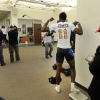 Photo - Wide receiver Justin Hunter strikes a pose after stepping off the scales during pro day at tge University of Tennessee, Wednesday, March 20, 2013, in Knoxville, Tenn.  (AP Photo/The Knoxville News Sentinel, Michael Patrick)