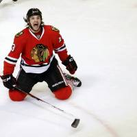 Photo - Chicago Blackhawks left wing Daniel Carcillo celebrates his winning goal during the third period of an NHL hockey game against the Colorado Avalanche, Wednesday, March 6, 2013, in Chicago. The Blackhawks won 3-2. (AP Photo/Charles Rex Arbogast)