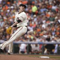 Photo - San Francisco Giants starting pitcher Tim Lincecum winds up in the seventh inning of the Giants' baseball game against the San Diego Padres on Wednesday, June 25, 2014, in San Francisco. Lincecum threw his second career no-hitter as San Francisco won 4-0. (AP Photo/Eric Risberg)