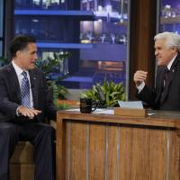 Photo -   In this photo provided by NBC, Republican presidential candidate, former Massachusetts Gov. Mitt Romney talks with Jay Leno during his appearance on The Tonight Show in Burbank, Calif., Tuesday, March 27, 2012. Romney cracked Tuesday night that he'd pick Leno rival David Letterman as his vice president, talked at length about health policy and said he'd be happy to have a rival of his own, Rick Santorum, serve in a Romney administration. (AP Photo/NBC, Paul Drinkwater)
