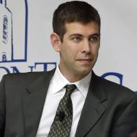Photo - FILE - In this April 10, 2013, file photo, Butler men's basketball coach Brad Stevens takes part in a panel on integrity in college basketball, in Nashville, Tenn. The Boston Celtics announced Wednesday, July 3, 2013, that Stevens was hired as the team's head coach, replacing Doc Rivers, who was traded to the Los Angeles Clippers. (AP Photo/Mark Humphrey, File)