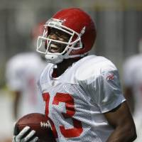 Photo - Kansas City Chiefs wide receiver Mark Bradley (83) laughs after catching a ball during NFL football training camp in River Falls, Wis., Tuesday, Aug. 4, 2009. The ball was batted in the air several times before Bradley came up with the catch. (AP Photo/Orlin Wagner) ORG XMIT: WIOW104