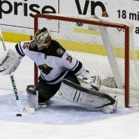 Photo - Minnesota Wild goalie Darcy Kuemper (35) deflects the puck against the Anaheim Ducks in the first period of an NHL hockey game in Anaheim, Calif., Tuesday, Jan. 28, 2014. (AP Photo/Reed Saxon)