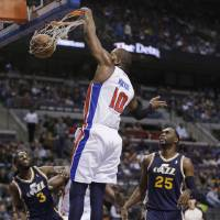 Photo - Detroit Pistons center Greg Monroe (10) dunks during the first quarter of an NBA basketball game against the Utah Jazz at the Palace of Auburn Hills, Mich., Saturday, Jan. 12, 2013. (AP Photo/Carlos Osorio)