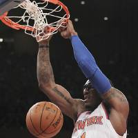 Photo - New York Knicks' Amare Stoudemire dunks during the first half of NBA basketball game against the Sacramento Kings, Saturday, Feb. 2, 2013, at Madison Square Garden in New York. (AP Photo/Mary Altaffer)