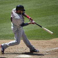 Photo - Cleveland Indians' Mike Aviles hits a two-run single during the eighth inning of a baseball game against the Los Angeles Dodgers on Wednesday, July 2, 2014, in Los Angeles. (AP Photo/Jae C. Hong)