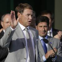 Photo -   European team captain Jose Maria Olazabal, right, watches as USA's captain Davis Love III speaks during the opening ceremony at the Ryder Cup PGA golf tournament Thursday, Sept. 27, 2012, at the Medinah Country Club in Medinah, Ill. (AP Photo/Chris Carlson)