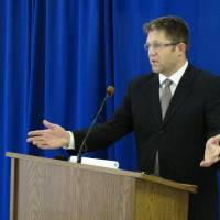 Photo - Federal public defender Allen Bohnert talks about the execution of his client, death row inmate Dennis McGuire, by a never-tried lethal drug process, on Thursday, Jan. 16, 2014 at the Southern Ohio Correctional Facility in Lucasville, Ohio. After McGuire repeatedly gasped over several minutes before dying, Bohnert called the procedure