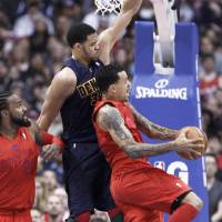 Photo - Los Angeles Clippers forward Matt Barnes, right, goes to lay up the ball as Denver Nuggets' JaVale McGee (34) defends and Clippers' Ronny Turiaf of France looks on during the first half of their NBA basketball game, Tuesday, Dec. 25, 2012, in Los Angeles. (AP Photo/Jason Redmond)