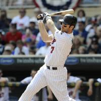 Photo -   Minnesota Twins' Joe Mauer hits a single off Detroit Tigers pitcher Anibal Sanchez in the first inning of a baseball game Sunday, Sept. 30, 2012 in Minneapolis. Mauer, in a race for the American League batting title, went 3-for-4 and a walk in the Tigers' 2-1 win. (AP Photo/Jim Mone)