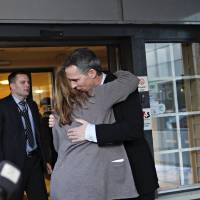 Photo - Norway's Prime Minister Jens Stoltenberg is embraced by Executive Vice President in Statoil, Margrethe Oevrum, Saturday Jan. 19,  2013, after his visit at the drop-in center in Bergen for relatives of the Statoil-employees taken hostage in Algeria. In a bloody finale on Saturday, Algerian special forces stormed a natural gas complex in the Sahara desert to end a four-day standoff with Islamic extremists that left at least 19 hostages and 29 militants dead. With few details emerging from the remote site, it was unclear whether anyone was rescued in the final operation. (AP Photo / Anette Karlsen, NTB scanpix) NORWAY OUT