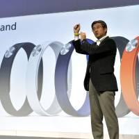 Photo - Kunimasa Suzuki, executive vice president, Sony Corporation and president and chief executive officer of Sony Mobile Communications, unveils the new Sony Smartband and Core during the Sony news conference at the International Consumer Electronics Show Monday, Jan. 6, 2014, in Las Vegas. The Smartband and Core track your daily life on your smart phone.(AP Photo/Jack Dempsey)