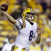 Photo - LSU quarterback Zach Mettenberger passes in the second half of an NCAA college football game against Auburn in Baton Rouge, La., Saturday, Sept. 21, 2013. LSU won 35-21. (AP Photo/Gerald Herbert)