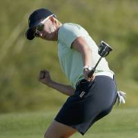 Photo - Karrie Webb, of Australia, pumps her fist after making a birdie putt on the 18th hole during the final round of the LPGA Founders Cup golf tournament on Sunday, March 23, 2014, in Phoenix. (AP Photo/Ross D. Franklin)