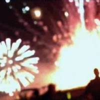 Photo - In this frame grab from video provided by Zach Reister, authenticated by checking against known locations and events, and consistent with Associated Press reporting, fireworks explode in the air and on the ground during a fireworks show in Simi Valley, Calif., Thursday, July 4, 2013. More than two dozen people were injured when a wood platform holding live fireworks tipped over, sending the pyrotechnics into the crowd at the Fourth of July show, authorities said Friday. (AP Photo/Zach Reister)