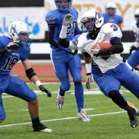Photo - HIGH SCHOOL FOOTBALL PLAYOFFS: Millwood's Cameron Batson runs towards the sidelines as Hennessey's Levi Hill (16) chases during the Class 2A semifinals between Millwood and Hennessey in Yukon, Saturday, December 3 2011. PHOTO BY HUGH SCOTT, FOR THE OKLAHOMAN ORG XMIT: KOD