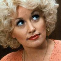 Dolly Parton in a scene from the 1980 comedy <em>9 to 5</em>. The film's theme song, performed by Parton, took on a life of its own