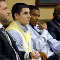 Photo - From left, Defense attorney Adam Nemann, his client, defendant Trent Mays, 17, defendant 16-year-old Ma'lik Richmond and his attorney, Walter Madison, listen to testimony during Mays and Richmond's trial on rape charges in juvenile court on Thursday, March 14, 2013 in Steubenville, Ohio. Mays and Richmond are accused of raping a 16-year-old West Virginia girl in August of 2012. (AP Photo/Keith Srakocic, Pool)