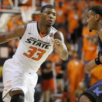 Photo -  Oklahoma State's Marcus Smart (33) goes around Memphis' Chris Crawford (3) during an NCAA college basketball game between Oklahoma State and Memphis at Gallagher-Iba Arena in Stillwater, Okla., Tuesday, Nov. 19, 2013. Photo by Bryan Terry, The Oklahoman
