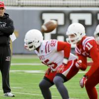 Photo - In this March 25, 2014 photo, Western Kentucky football coach Jeff Brohm watches over his first practice as head coach at Houchens-Smith Stadium, in Bowling Green, Ky. (AP Photo/Daily News, Alex Slitz)