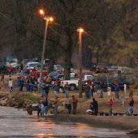 Photo - FISHING: Paddlefish anglers swarmed the banks of the Neosho River in Miami's Riverview Park on Wednesday night to try and snag a spoonbill. PHOTO BY GARY CROW, FOR THE OKLAHOMAN ORG XMIT: 0903272111212246
