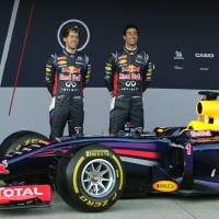 Photo - Infiniti Red Bull Racing drivers Sebastian Vettel of Germany, left, and Daniel Ricciardo of Australia, right, attend the launch of their new RB10 Formula One car at the Circuito de Jerez on Tuesday,  Jan. 28, 2014, in Jerez de la Frontera, Spain. (AP Photo/Miguel Angel Morenatti)