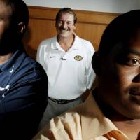Photo - HIGH SCHOOL FOOTBALL: State 4A football preview. Star Spencer coach Darrell Hall, left and Douglass coach Willis Alexander, right, with Oklahoma City Public Schools athletic director Phil Ingersoll. The two schools teams will play Class 4A championship Saturday.      Dec. 3, 2009. Photo by Doug Hoke, The Oklahoman  ORG XMIT: KOD