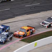 Photo -   Jimmie Johnson (48) takes the lead from Brad Keselowski (2) during the NASCAR Sprint Cup Series auto race at Martinsville Speedway, Sunday, Oct. 28, 2012, in Martinsville, Va. (AP Photo/Steve Sheppard)