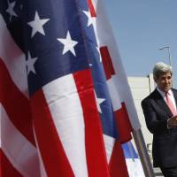 Photo - U.S. Secretary of State John Kerry arrives in Tel Aviv, Israel, Thursday, May 23, 2013. (AP Photo/Jim Young, Pool)