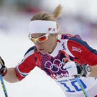 Photo - Norway's Astrid Uhrenholdt Jacobsen starts the women's qualification of the cross-country sprint at the 2014 Winter Olympics, Tuesday, Feb. 11, 2014, in Krasnaya Polyana, Russia. (AP Photo/Matthias Schrader)