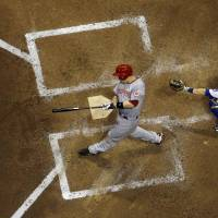 Photo - Cincinnati Reds' Todd Frazier hits an RBI single during the fifth inning of a baseball game against the Milwaukee Brewers Friday, June 13, 2014, in Milwaukee. (AP Photo/Morry Gash)
