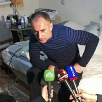Photo - The father of the Boston bomb suspects, Anzor Tsaraev, speaks to the media at his home in Makhachkala, the capital of Dagestan, a predominantly Muslim republic in southern Russia, Friday, April 19, 2013.  The two ethnic Chechen brothers, Tamerlan Tsarnaev and Dzhokhar Tsarnaev,  turned suspects in US marathon bombing, one dead, one still alive and at large on Friday, came from Dagestan, a Russian republic bordering the province of Chechnya. (AP Photo/Kurban Labazanov)
