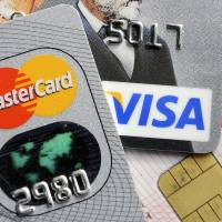 Photo -   This  2009 file photo shows credit and bank cards with electronic chips in Gelsenkirchen, Germany. In the wake of recent high-profile data breaches, including this week's revelation that hackers stole consumer data from eBay's computer systems, Visa and MasterCard are renewing a push to speed the adoption of microchips into U.S. credit and debit cards. AP File Photo   Martin Meissner -  AP