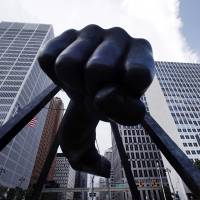 Photo - The Detroit skyline rises behind the Monument to Joe Louis, also known as