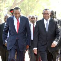 Photo - In this photo released by the Kenyan Presidential Press Service, Kenyan President Uhuru Kenyatta , left, and Ethiopian Prime Minister Hailemariam Desalegn, right, arrive for a meeting with South Sudanese President President Salva Kiir at State House in Juba, South Sudan, Thursday, Dec. 26, 2013. The leaders of Kenya and Ethiopia arrived in South Sudan on Thursday to try and mediate between the country's president and the political rivals he accuses of attempting a coup that the government insists sparked violence threatening to destroy the world's newest country.  (AP Photo/Kenyan Presidential Press Service)