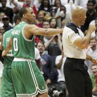 Photo -   Boston Celtics' Avery Bradley, center, puts his arm around Rajon Rondo, rear left, and walks him off the court as he is ejected from the game by referee Marc Davis late in the fourth quarter of Game 1 of a first-round NBA basketball playoff series against the Atlanta Hawks, Sunday, April 29, 2012, in Atlanta. The Hawks won 83-74. (AP Photo/Atlanta Journal-Constitution, Curtis Compton) MARIETTA DAILY OUT; GWINNETT DAILY POST OUT