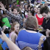Photo -  The Swon Brothers, from left, Colton and Zach Swon, are greeted by fans as they get off of a bus at the Civic Center in Muskogee, Okla., Thursday, June 6, 2013. Photo by Garett Fisbeck/Tulsa World