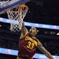 Photo - Cleveland Cavaliers forward Alonzo Gee (33) dunks during the first half of an NBA basketball game against the Orlando Magic in Orlando, Fla., on Saturday, Feb. 23, 2013. (AP Photo/Reinhold Matay)