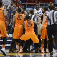 Photo - As Kansas built a big first half lead over Oklahoma State, tempers flared at Allen Fieldhouse in Lawrence, Kan., on Saturday, Jan. 18, 2014. (Rich Sugg/Kansas City Star/MCT)