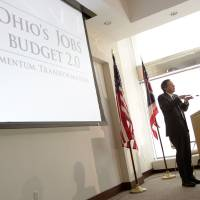 Photo - Ohio Gov. John Kasich answers questions about the fiscal year 2014-15 executive budget proposal during a news conference Monday, Feb. 4, 2013, in Columbus, Ohio. (AP Photo/Jay LaPrete)