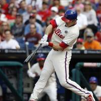 Photo - Philadelphia Phillies' Chase Utley hits a two-run home run off Los Angeles Dodgers starting pitcher Dan Haren during the first inning of a baseball game, Saturday, May 24, 2014, in Philadelphia. (AP Photo/Matt Slocum)