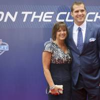 Photo - Central Florida quarterback Blake Bortles, right, poses for photos with his mother, Suzy Bortles, upon arriving for the 2014 NFL Draft, Thursday, May 8, 2014, at Radio City Music Hall in New York. (AP Photo/Craig Ruttle)