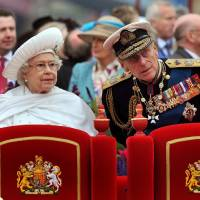 Photo -   FILE - A Sunday June 3, 2012 photo from files showing Britain's Queen Elizabeth II, and her husband Prince Philip watching the proceedings from the royal barge during the Diamond Jubilee Pageant on the River Thames in London. Buckingham Palace says Prince Philip, husband of Queen Elizabeth II, has been hospitalized with a bladder infection. The 90-year-old prince has been taking part in celebrations of the queen's Diamond Jubilee. (AP Photo/John Stillwell, Pool, File)