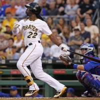 Photo - Pittsburgh Pirates' Andrew McCutchen (22) hits a two-run home run off Chicago Cubs starting pitcher Edwin Jackson during the third inning of a baseball game in Pittsburgh Monday, June 9, 2014. (AP Photo/Gene J. Puskar)
